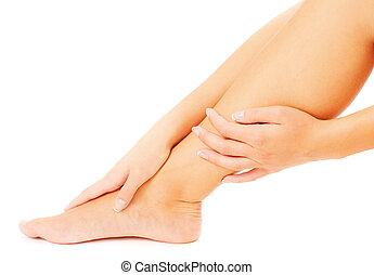 Hands Massaging Leg