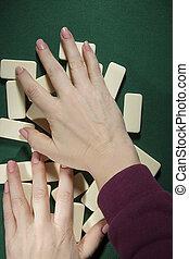 Hands mixing dominoes - Female hands mixing domino bones on ...