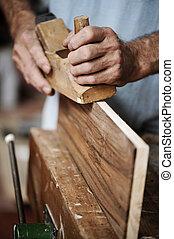 hands of a carpenter, close up - hands of a carpenter ...