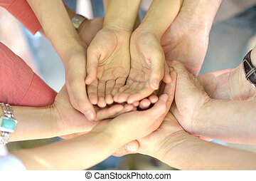Hands of a family - Hands of a friendly family together...