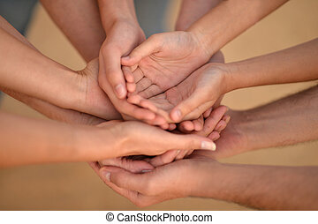 Hands of a family together