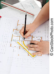 female architect drawing a plan