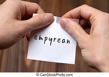 Cancelling empyrean. Hands tearing of a paper with handwritten inscription.