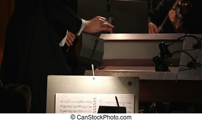 hands of a man who conducts orchestra - the hands of a man...