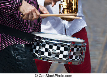 hands of a musician with a drum
