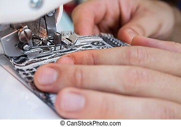 Hands of a tailor at work