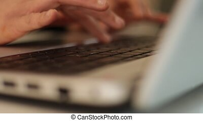 Hands of a woman type on laptop keyboards
