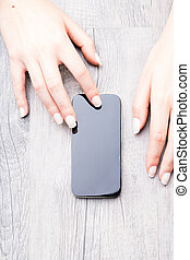Hands of a woman with a modern mobile