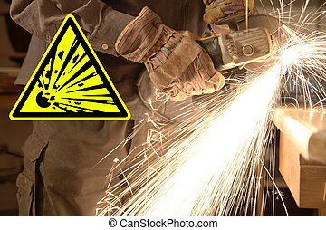 Hands of a worker with angle grinder, sparks and sign