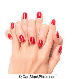 Hands of a young woman with red manicure on nails