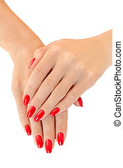 Hands of a young women.  Red nail polish