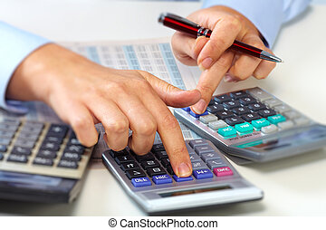 Hands of accountant woman.