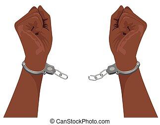 hands of african american man breaking steel handcuffs...