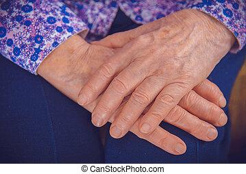 Hands of an elderly grandmother