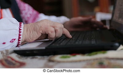 Hands of an old woman running on your keyboard