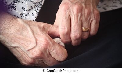 hands of an old woman - hands of an elderly woman pressed a...