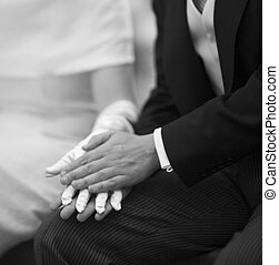 Hands of bride and bridegroom in wedding marriage ceremony -...