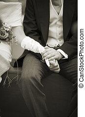 Hands of bride and bridegroom in wedding marriage ceremony -...
