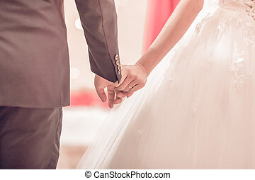 Hands of bride and groom with rings Interpretation of love. Wedding couple