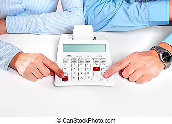 Hands of business person working with calculator.