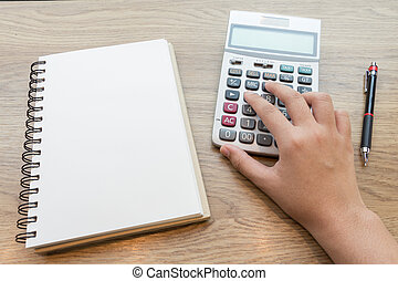Hands of business woman working with calculator