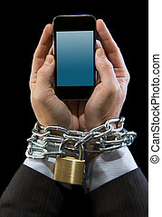 Hands of businessman addicted to work chain locked in mobile phone addiction