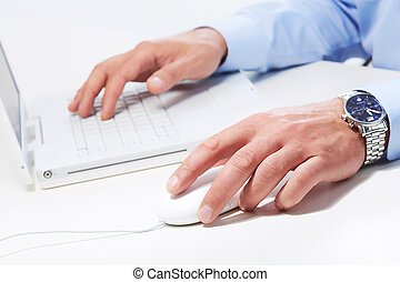 Hands of businessman with laptop.