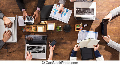 Hands Of Businesspeople On Office Desk