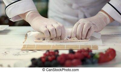 Hands of chef cooking dessert.