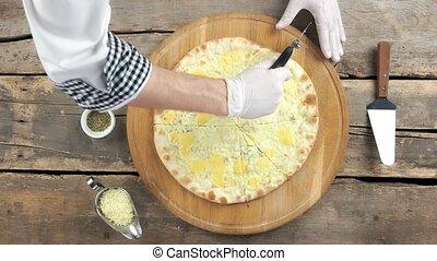 Hands of chef, pizza. Thin crust, mozzarella and parmesan.