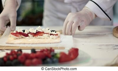Hands of chef preparing dessert.