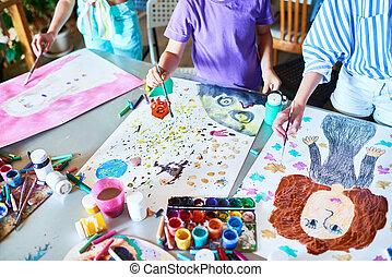 Hands of Children Painting in Art Class