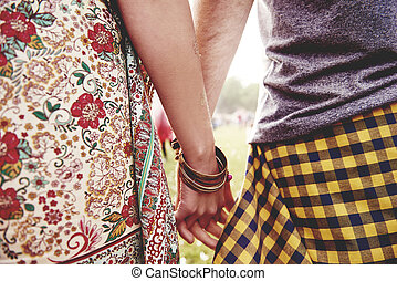 Hands of couple at the festival