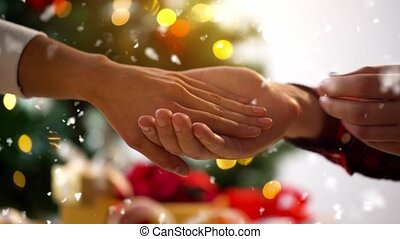 hands of couple with diamond ring on christmas - holidays, ...