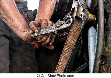 hands of dirty worker