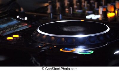 Hands of DJ plays music mixing and scratching, close-up. -...