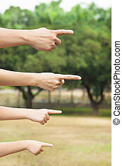 hands of family pointing to same direction