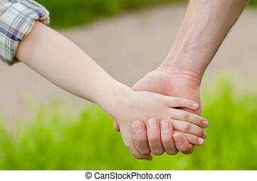 hands of father and child