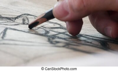 Hands of female artist draws sketces of nude model , close up