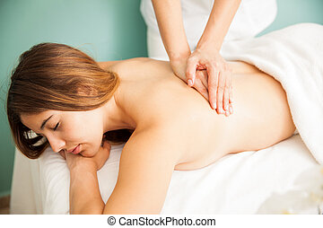 Hands of female therapist giving a massage