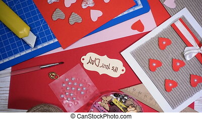 hands of girl making scrap Valentine greeting card