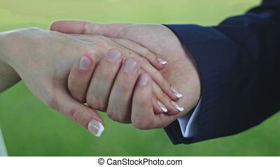 Hands of groom and bride, outdoor, close up