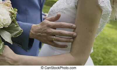 Hands of lovers who caress each other.