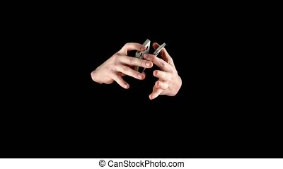 Hands of magician continue to showing his trick with usual cards, cardistry on black background