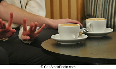 Hands of man and woman holding cups with coffee