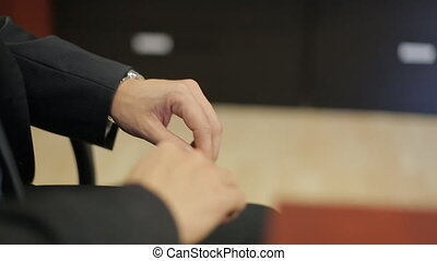 Hands of man during the discussion