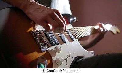 Hands of man playing electric guitar. Bend technique. rock...