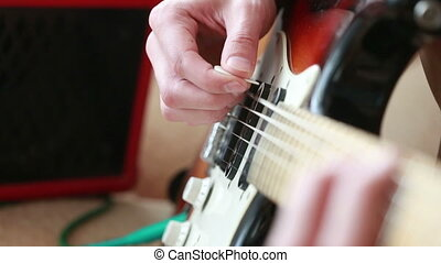 Hands of man playing electric guitar. rock.