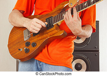 Hands of man put guitar chords