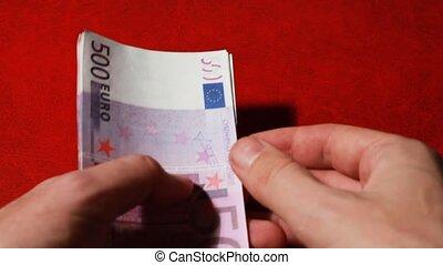 Hands of man souvenir banknote five hundred euros - Closeup...